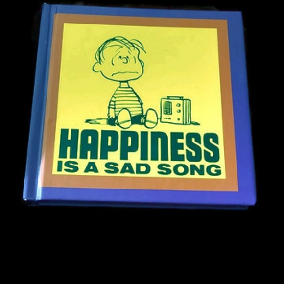 Peanuts happiness is a sad song book.